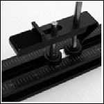 Box clamp with ridges and trap slot (20mm/.781